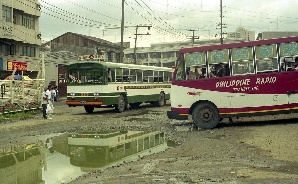 Baliwag Transit Mitsubishi Fuso CVK-637 (fleet No 389) and Philippine Rapid Transit Nissan Antonio Rivera Street near Tutuban Railroad Station, Manila, Philippines.