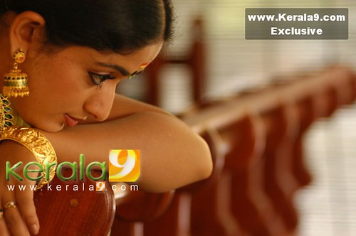 Actress Kavya Madhavan in pensive or shy mood