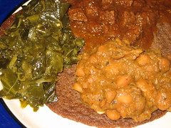 Ethiopian: collards, beans and beef over Gluten free injera