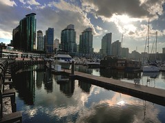 The seawall at Coal Harbour (Eyesplash - What happened to winter) Tags: sky sun reflection water clouds marina boats pier communitycentre platform seawall walkway yachts condominiums happycanadaday justclouds thefollowingtagisjusttoseeifitgetsmoreattention happybirthdaymikejones thelastphotowiththattaggotalmost2000viewslol