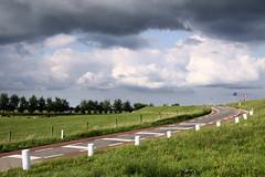 Dutch Dike  Diagonal (mikel.hendriks) Tags: dutch clouds landscape nederland thenetherlands wolken explore dyke dijk frontpage dike embankment landschap levee levée floodbank canonefs1785mmf456isusm stopbank abigfave canoneos50d