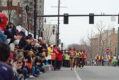 Lead Women's pack heading through Coolidge Corner