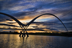 IMG_7685 Spicify (lepista) Tags: new uk bridge sunset clouds photoshop river foot arch footbridge infinity yorkshire cleveland north ne east explore sillouette curve northeast stockton topaz tees adjust teeside spicify