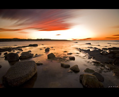 U n s u r e (Paul Santos Photography) Tags: ocean sunset orange coast rocks tide wide tokina 1224 stmarys whitleybay d90 10stop