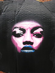 untitled stencil on cardboard.. (asboluv) Tags: blue stencil lips cardboard stare asbo afrogirl grafikwarfare asboluv robert21