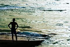 "Talk to the sea! (""Anwaar) Tags: blue man black guy green beach colors silhouette yellow standing canon see mixed waves talk 100mm daisy kuwait q8 bnaider anwar 400d anwaar lifeinsevenpages"
