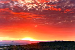 Hot As Hell (jimhankey) Tags: park morning red summer arizona sky cloud sun mountain mountains phoenix weather clouds sunrise landscape dawn morninglight desert cloudy scenic parks sunny valley vista dramaticsky 2009 beautifulclouds beautifulview sunray desertview phoenixarizona southmountain phoenixaz cumulous scenicview desertmountain maricopacounty nikond200 unusuallight glowingcloud dearflickrfriend jimhankey arizonasummer arizonaweather phoenixweather phoenixariz azwfavorite2009
