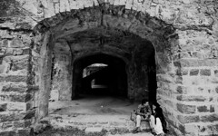 Stealing a moment (knowsnotmuch) Tags: bw film ruins fuji fort candid arches hyderabad pp sensia golconda nikonf4 3570