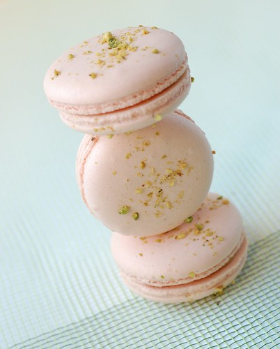 an Arabesque macaron, filled with a dollop of apricot jelly and white chocolate pistachio ganache