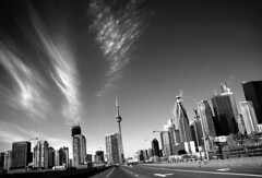 Gardiner Heading West [explored} (red_dotdesign) Tags: city sky bw toronto skyline clouds highway cntower financialdistrict gardiner westbound blueribbonwinner