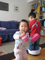 Aki showing shoes. Owen in a bowl.