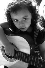 guitar girl (pete.holmes) Tags: music white black girl hand guitar acoustic strings thechallengegame challengegamewinner guardiancameraclub httpwwwphocusimagescouk