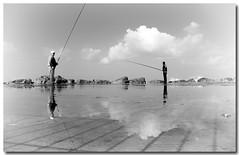 tel-baruch beach (Daniel Bendheim) Tags: reflection beach israel telaviv fisherman tel aviv