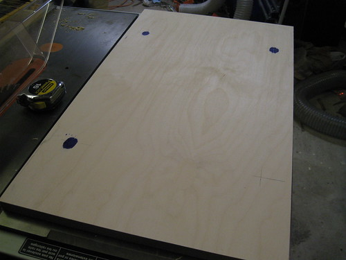 blue drops on plywood, showing transferred hole positions from planer base