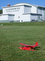 Radio-controlled plane in the grass of Lansdowne Middle School