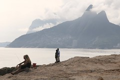 Seaside contemplation (chris.bryant) Tags: ocean morning sea brazil people sun sol southamerica riodejaneiro clouds fishing agua marine rocks sitting hills nubes sit romantic geology picturesque seated soe ipanema rockformations sudamerica americadosul blueribbonwinner otw peoplestanding peoplesitting 5photosaday platinumphoto diamondclassphotographer flickrdiamond pontadoarpoador aplusphotos concordians platinumheartaward theperfectphotographer simplysuperb worldtrekker rubyphotographer qualitypixels panoramafotogrfico brazilcom artofimages atomicaward expressyourselfaward mistcouples