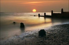 Tide at Whitstable (adrians_art) Tags: longexposure sea sky cloud sun beach water silhouette sunrise dawn shadows tide shore peebles whitstable groynes superaplus aplusphoto colourartaward saariysqualitypictures