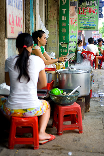 At a stall selling bánh canh cá lóc, a fish and noodle dish, Hue, Vietnam
