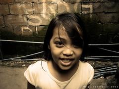 girl, manila (viewfinderview) Tags: portrait people girl face grafitti child philippines manila slum