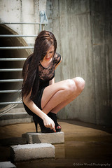 Nadine, Another Little Black Dress, #2 (Mike Wood Photography) Tags: woman water hair concrete outdoors eos industrial lace longhair arr heels nadine vignette allrightsreserved longlegs squatting littleblackdress mikewood 450d platinumheartaward mikewoodphotography
