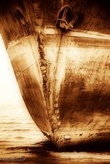 Heaviness /  (Tikke Sang) Tags: sea beach water sepia nikon ship iran persia nostalgia gravity anchor iranian  bandarabbas    heaviness  d80 kartpostal       ghodrat  tikkesang