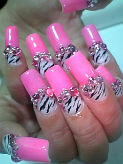 Pink nails with zebra stripes decorated nail art