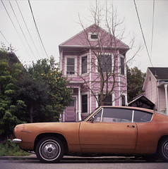 Gold car, pink house (Dead Slow) Tags: vintagecar suburban neighborhood alameda smalltown yashicamat124g deadslow fujipro400h plymouthbarracuda christopherhall
