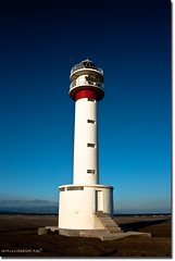 lighthouse (arturii!) Tags: travel blue light red sea sky lighthouse white tower beach skyline stairs wow river landscape faro mar amazing interesting sand europa europe day torre floor superb dunes awesome sunny ground delta cel catalonia route journey viatge vermell catalunya arrow blau ebro polarized terra far blanc catalua tarragona gettyimages ciment platja llum sorra riu paisatge escales mediterranian deltebre ebre franja catalogne mediterrani fletxa montsia horitz polaritzador placasolar