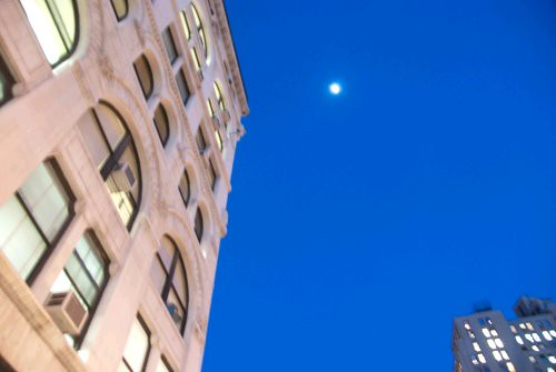 The moon against the blue sky in New York City