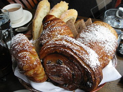 Basket of freshly baked breads, croissants + pastries