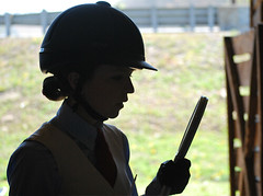 Touch Up (ginfox) Tags: horse black girl look grass mirror helmet makeup stall human bow gloss horseshow lipgloss