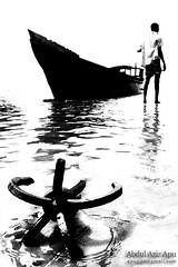 anchored... ( (double-A Apu)) Tags: man canon boat anchor highkey bangladesh bnw netrokona birishiri