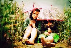 Umbrella Girls.. (ecca) Tags: girls portrait people selfportrait silly field umbrella self fun sitting wheat norfolk umbrellas brolly wheatfields vrinda sigma30mmf14 gorillapod eviee domeumbrella