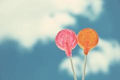 Suckers In Love (taylorkoa22) Tags: pink blue sky orange white color love clouds fun sticks backyard kiss flash sb600 lovers silliness lollipop shenanigans strobe suckers marcgutierrez strobist