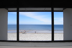Room with a view (harry.1967) Tags: uk sea summer sky people beach window lines wales coast seaside view britain pebbles gb shelter ricoh llandudno andrewlee sooc sunseaandsand capliogx100 harry1967