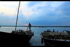 an evening in Ganga. (munna1960) Tags: blue boy sunset people india art nature water canon river geotagged boat asia flickr you tag award contacts come geotag ganga exif explored platinumheartaward googlechrome mygearandmepremium mygearandmebronze flickrawardgallery