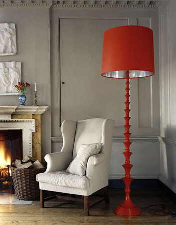 White wingback chair and red lamp by decorology.