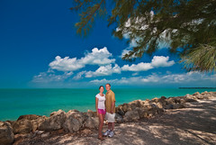 Carl and Becky at the beach in Fort Zachary Taylor Historic State Park - Key West, Florida (Carl's Photography) Tags: pink blue summer people white tree green clouds landscape iso100 saturated nikon nef florida outdoor vibrant sb600 bluesky f90 carl becky saturation fl keywest lightroom vibrance 1200s sigma1020mm 10mm sb800 sigma1020mmf456exdchsm adobelightroom d80 fortzacharytaylorhistoricstatepark strobist nikond80 sb900 rawnef adobephotoshopcs4 gettyvacation2010