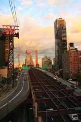 Sunset on Tramway along Queens Borough Bridge (Charles Chi Zhang) Tags: nyc newyorkcity sunset summer cloud sun newyork tram queens queensborobridge rooseveltisland queensboroughbridge rooseveltislandnewyorkeastriver