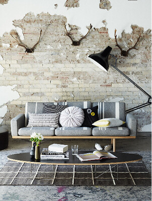 grey exposed brick w antlers