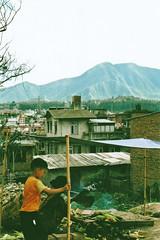 Woman cooking corn (jennygutteridge) Tags: street city nepal boy urban mountains cooking corn smoke hills kathmandu