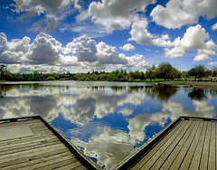 Trout Lake Mirror (Christopher J. Morley) Tags: blue sky reflection water vancouver clouds photography mirror dock lunchtime symmetry explore frontpage troutlake mygearandmegold