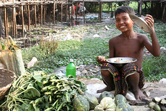 Happy with a meal (martien van asseldonk) Tags: boy dhaka bangladesh martienvanasseldonk