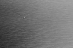 gulf crossing (lecates) Tags: ocean sea bw gulfofmexico water monochrome boat iso200 nikon waves ship gulf florida flight surface aerial f8 d300 105mm 0ev 1800sec 105mmf28gvrmicro