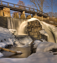 Melting (mortenprom) Tags: wood longexposure bridge blue winter light brown white snow plant color reflection tree ice nature wet water yellow oslo norway stone architecture forest fence river landscape concrete golden march norge woodwork waterfall stream day skandinavien gray norwegen sunny wideangle explore rails granite noruega scandinavia 2009 noorwegen noreg wideangel skandinavia nd1000 canon1755mmf28 nd30 bw110 canoneos40d nd1000x naturaldensityfilter mortenprom