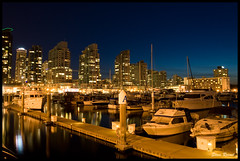 Coal Harbour Twilight (Steve Rosset) Tags: ocean city blue sea sky urban skyline night vancouver marina buildings reflections geotagged boats twilight sailing waterfront skyscrapers dynamic harbour vibrant towers tagged highrise coal geo steverosset steverossetphotography