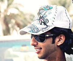 جرحك ظهر لو قلت للوجه خبهـ ~ وللحزن في ضحكتك رسوم وعلامآت (★Ᾰΐΐα-7αseβκ) Tags: portrait smile sunglasses nikon khaled الله alla alsuwaidi خالد d90 السويدي حسيبك 7asebk