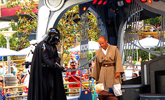 Darth Vader conning a youngling to the dark side. (Profound Introvert) Tags: california star disneyland darth wars vader