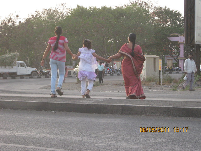 Crossing the busy Nagar Road at Wagholi, Kharadi annexe, Pune