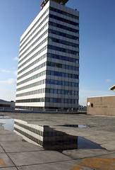 Plash reflections (Christian Reiprich) Tags: reflection telekom hochhaus pftze parkaus